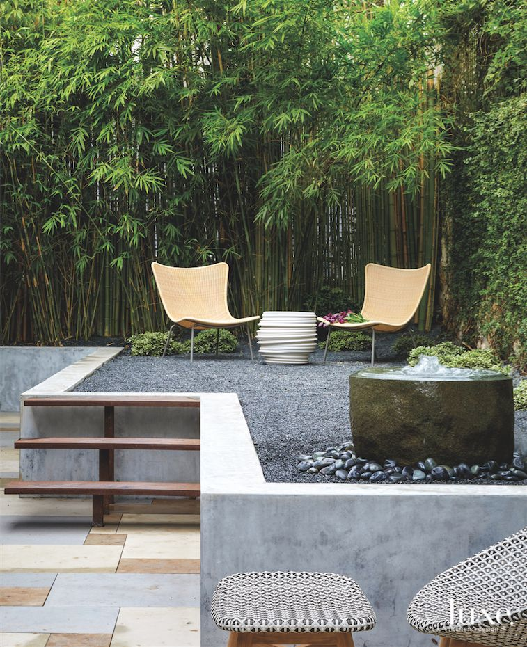 Outdoor Seating Corner with Gravel, Water Feature and Ottoman