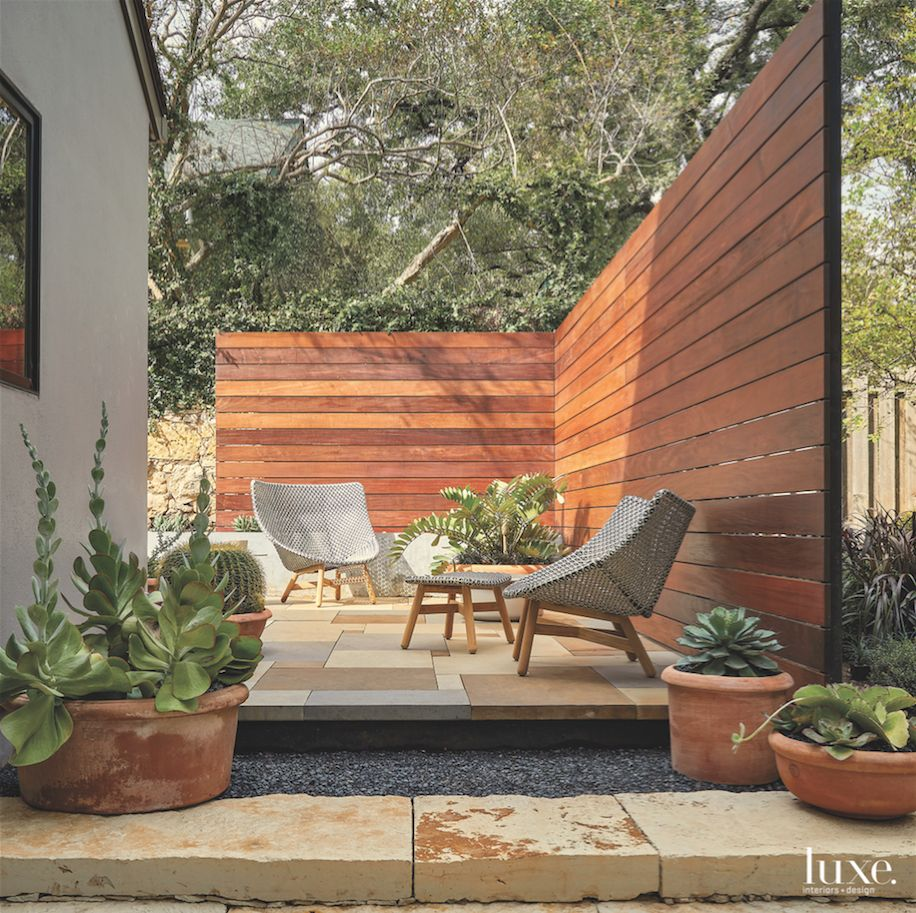 Corner Wood Outdoor Seating Area with Outdoor Furniture and Plants