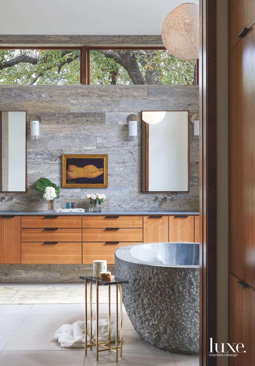 Gray and Wood Master Bathroom with Stone Soaking Tub and Side Table