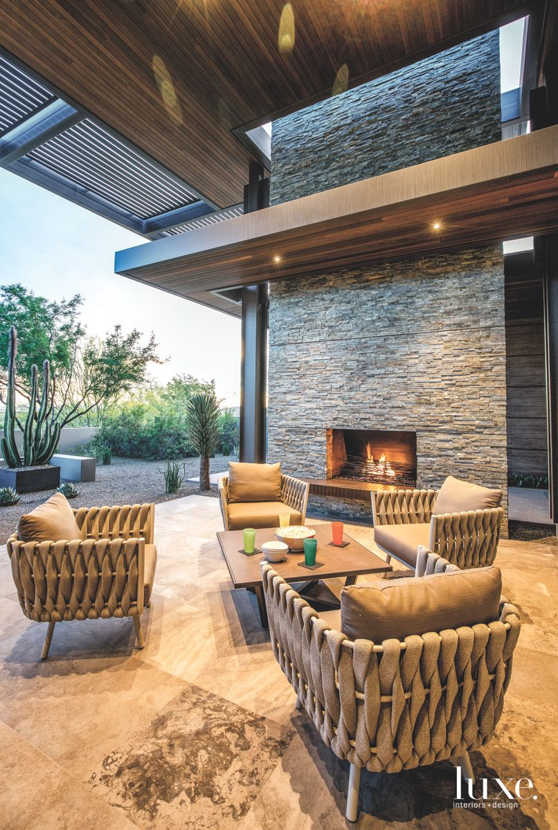 Gray Floor to Ceiling Stone Fireplace with Outdoor Furniture