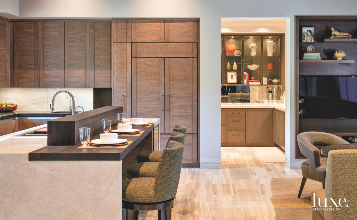 Natural Wooden Cabinetry with Quartz Backsplash Kitchen and Bar Seating