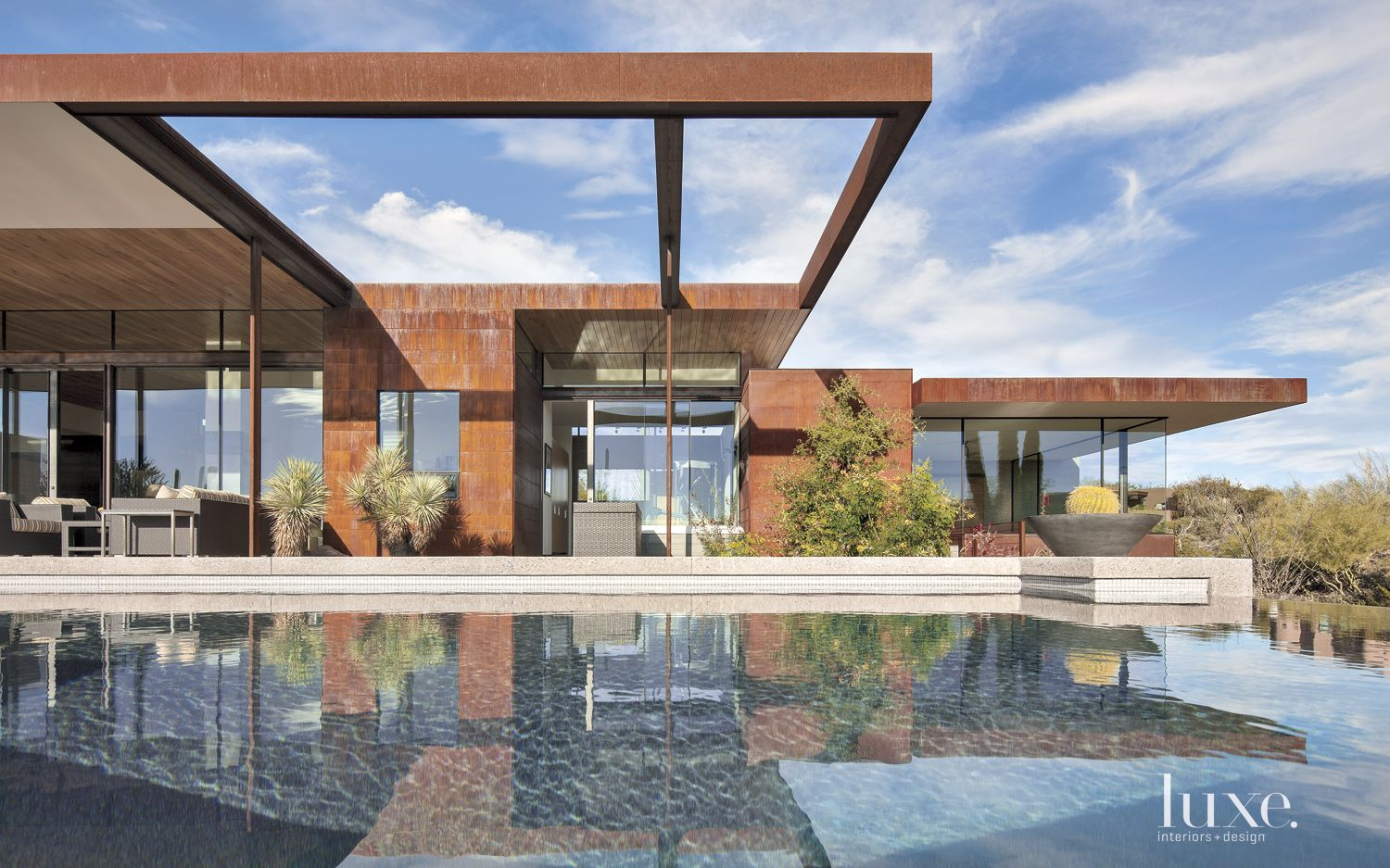 Contemporary Brown Front Elevation With Exposed Steel Frame