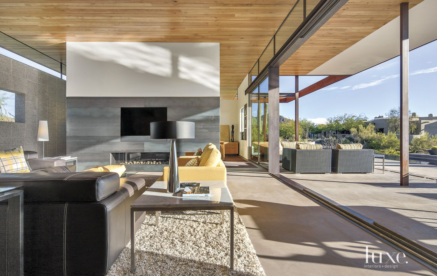 Contemporary Gray Living Room With Steel Panel Fireplace