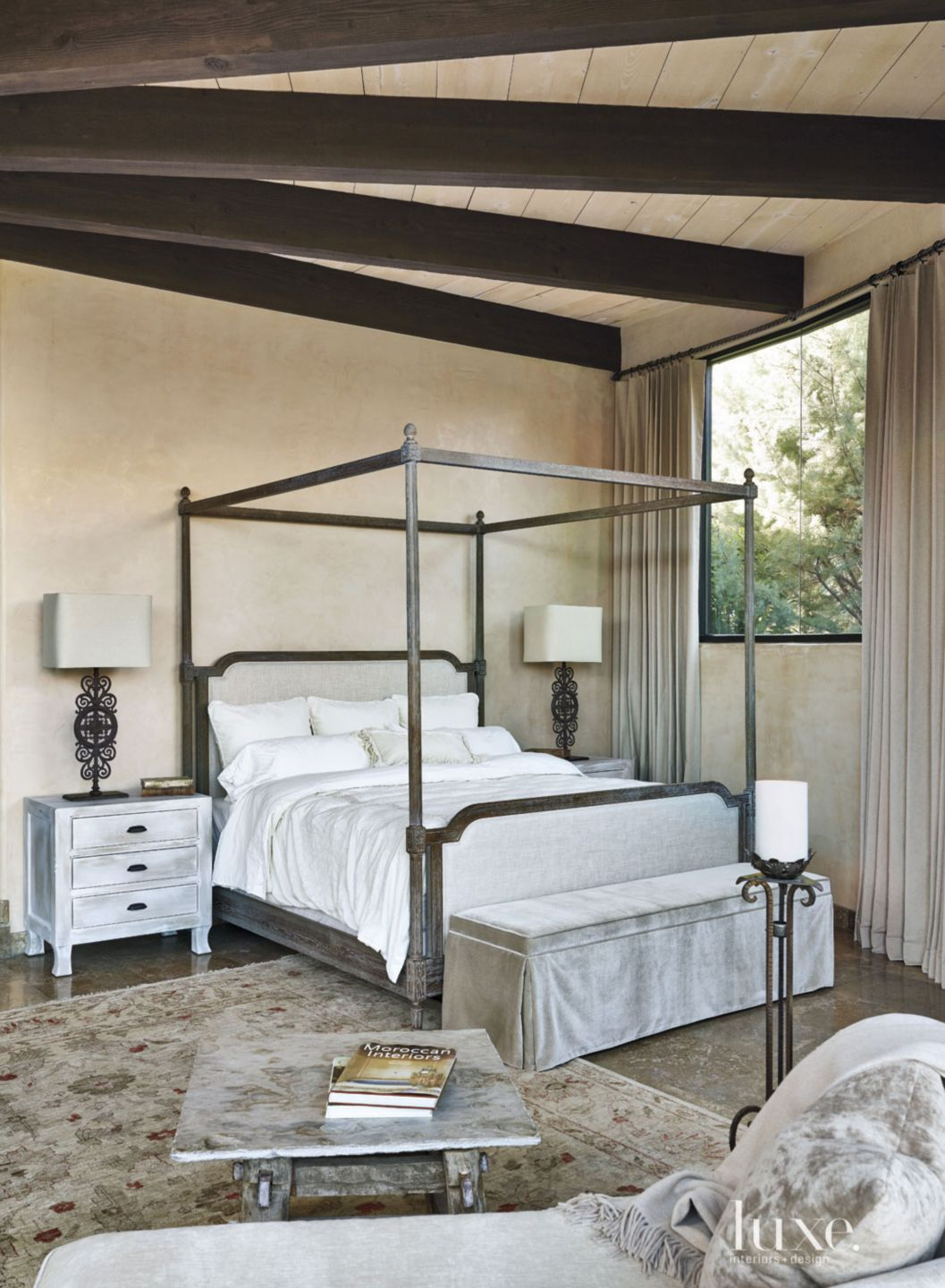 Mediterranean Cream Master Bedroom with Exposed Beams