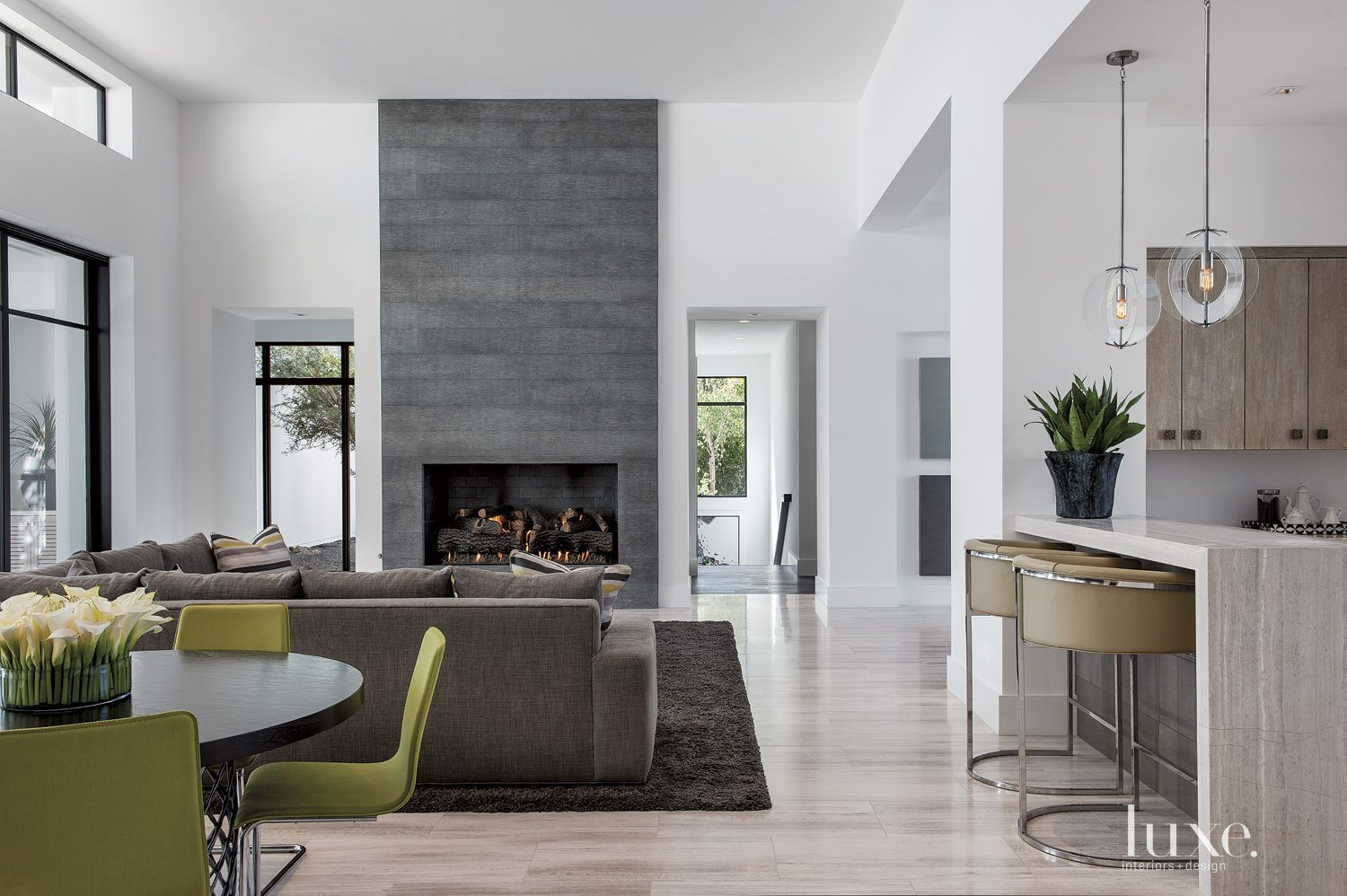 Modern White Living Room With Floor To Ceiling Fireplace