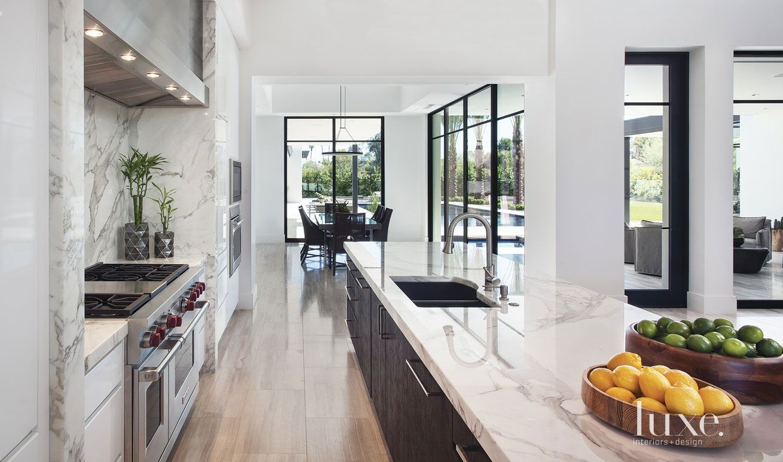 Modern White Kitchen With Limestone Flooring