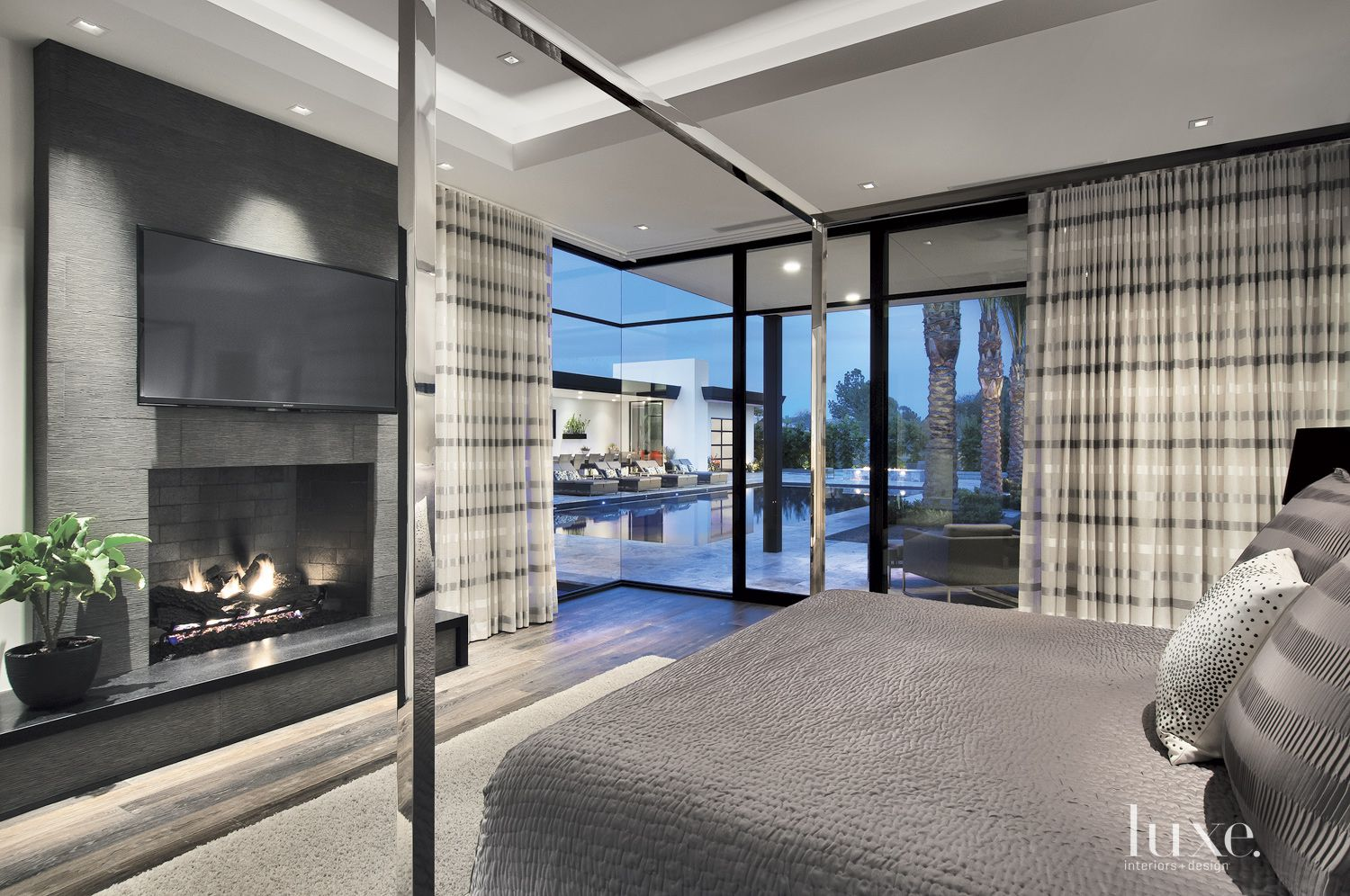Modern Gray Bedroom with Earth-Toned Fireplace