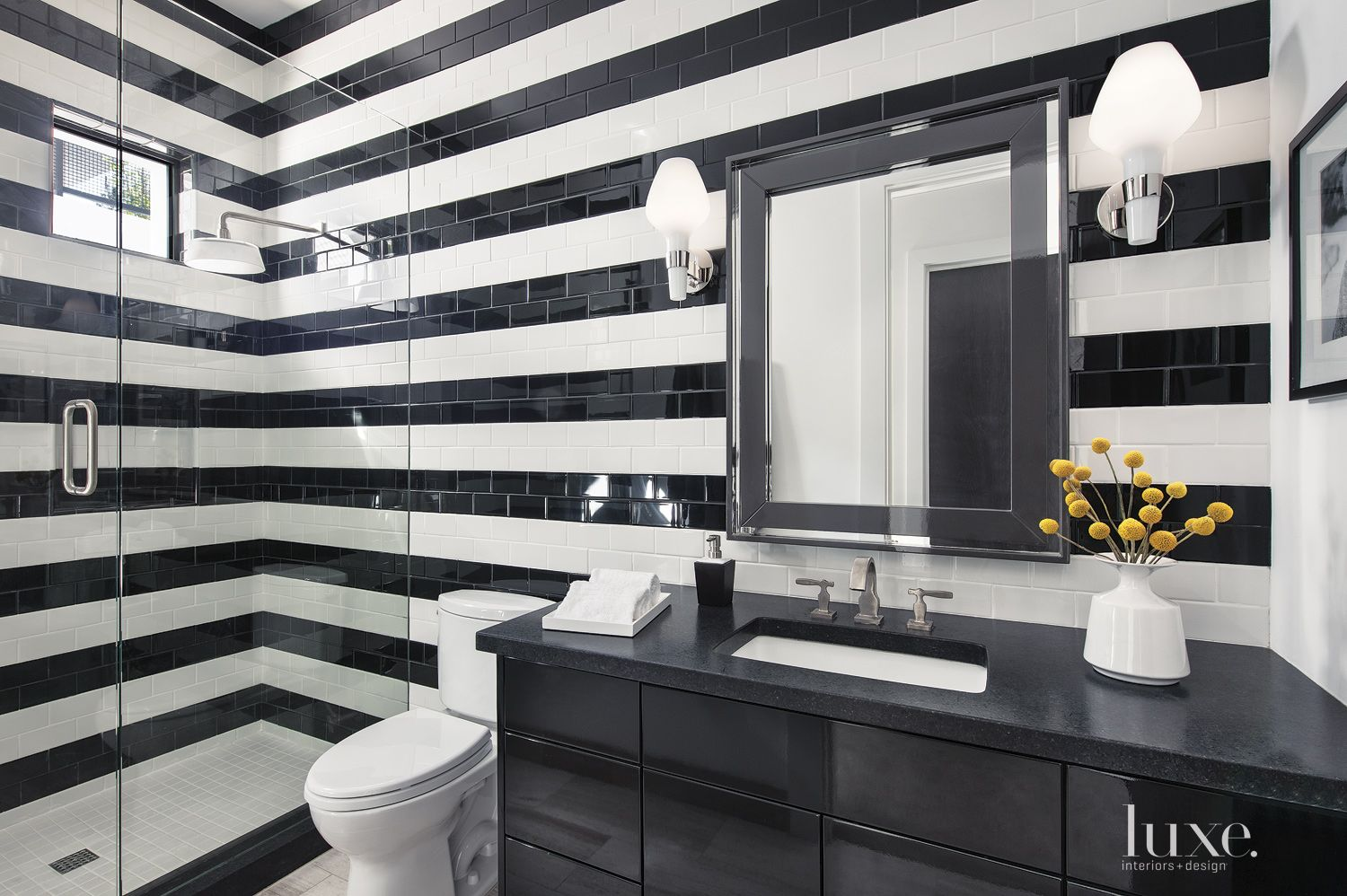 Modern White Bathroom With Striped Wall Detail