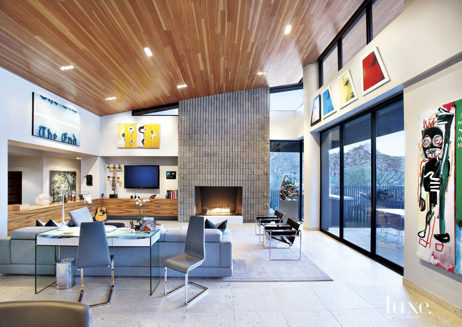 Modern White Family Room with Sloped Ceiling