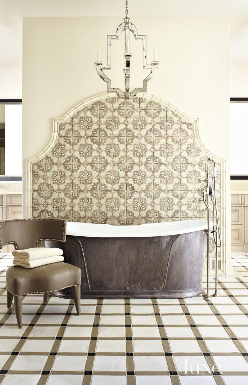 Mediterranean Cream Master Bath Tub with Elegant Backdrop
