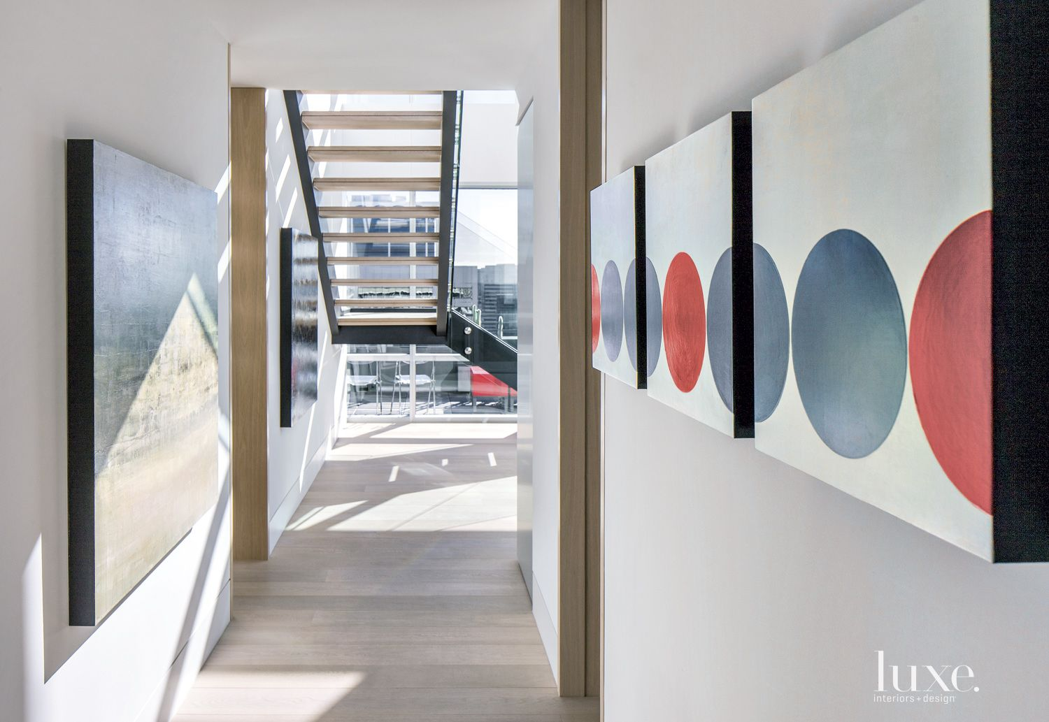 Contemporary White Hallway with Triptych