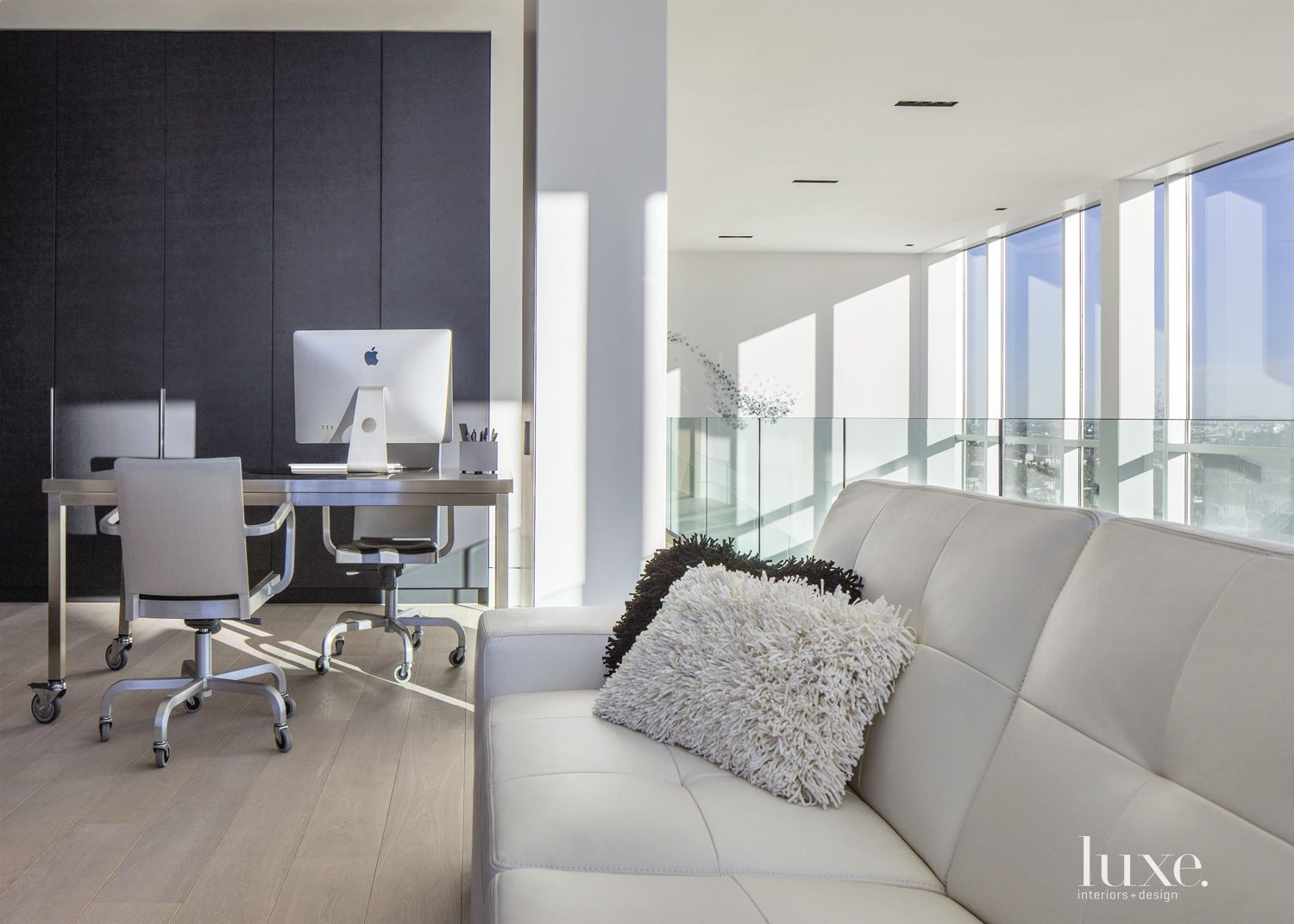 Contemporary Neutral Office with White Leather Sofa