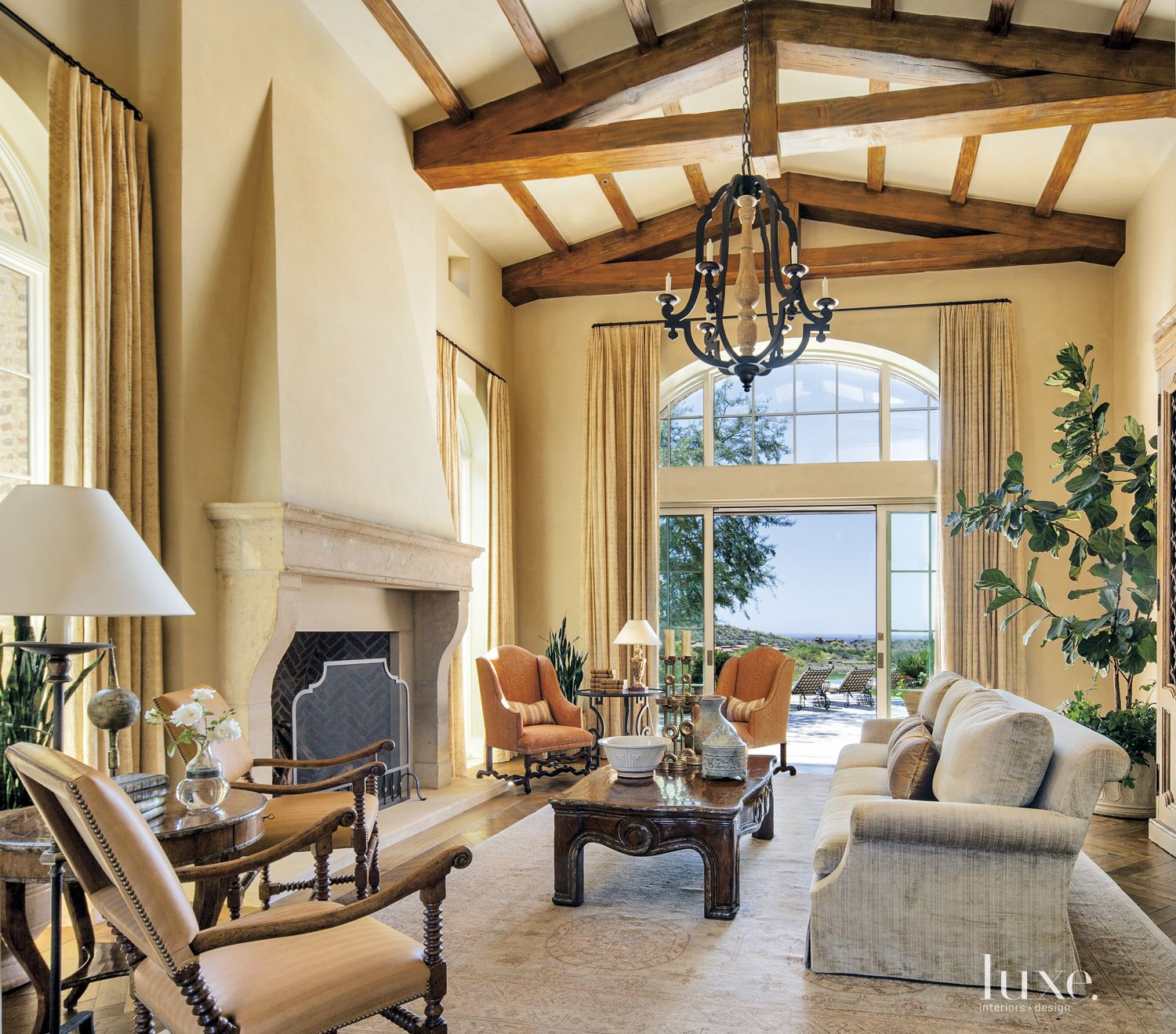 Mediterranean Cream Living Room with Antique Limestone Fireplace