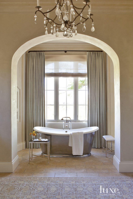 Mediterranean Cream Bathroom with Bathing Alcove