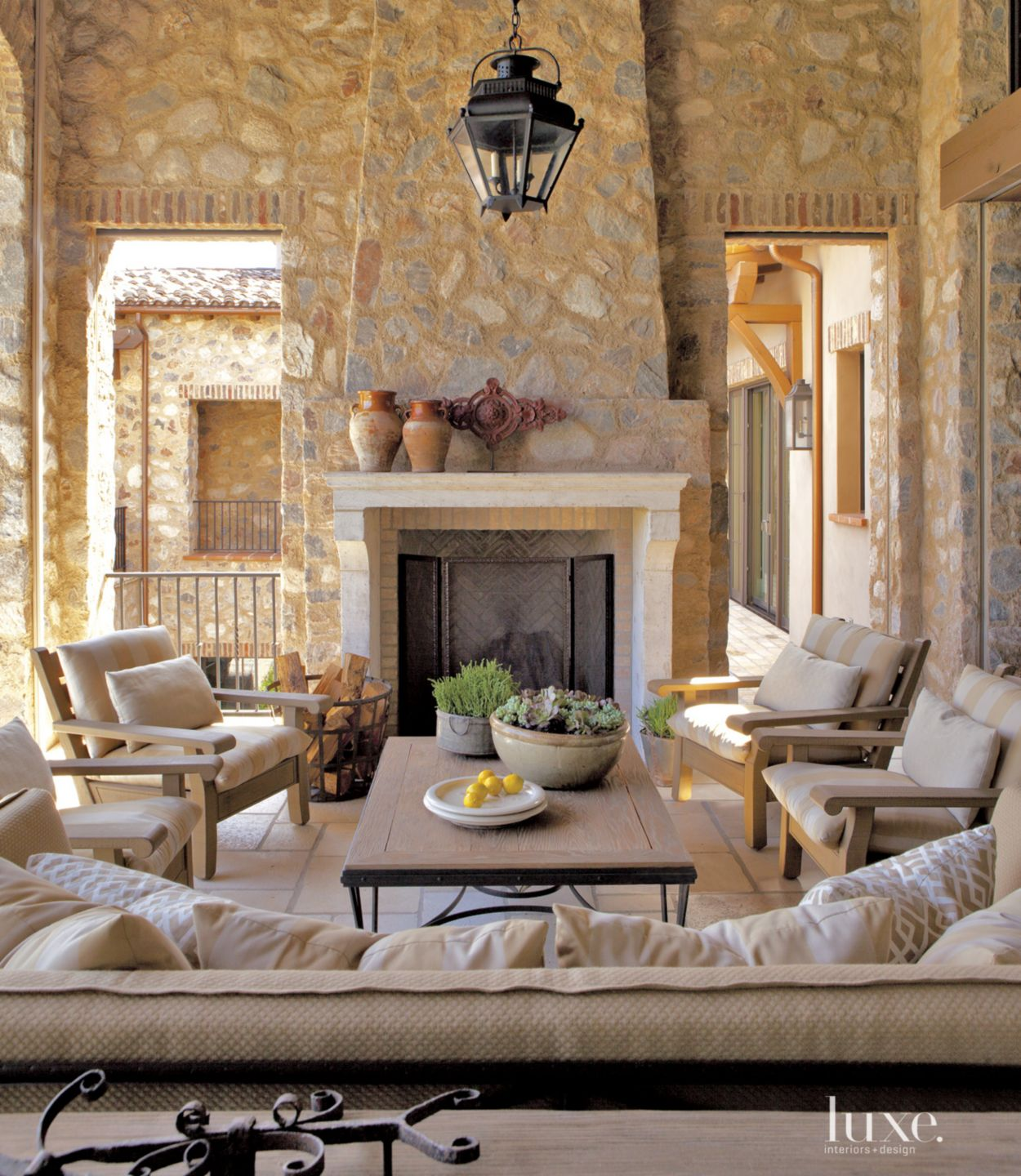 Mediterranean Neutral Courtyard with Outdoor Fireplace