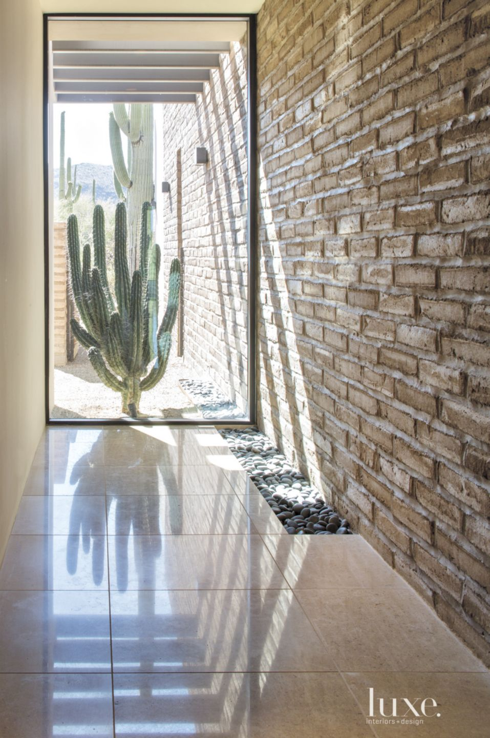 Contemporary Neutral Hallway with River Rock Wall