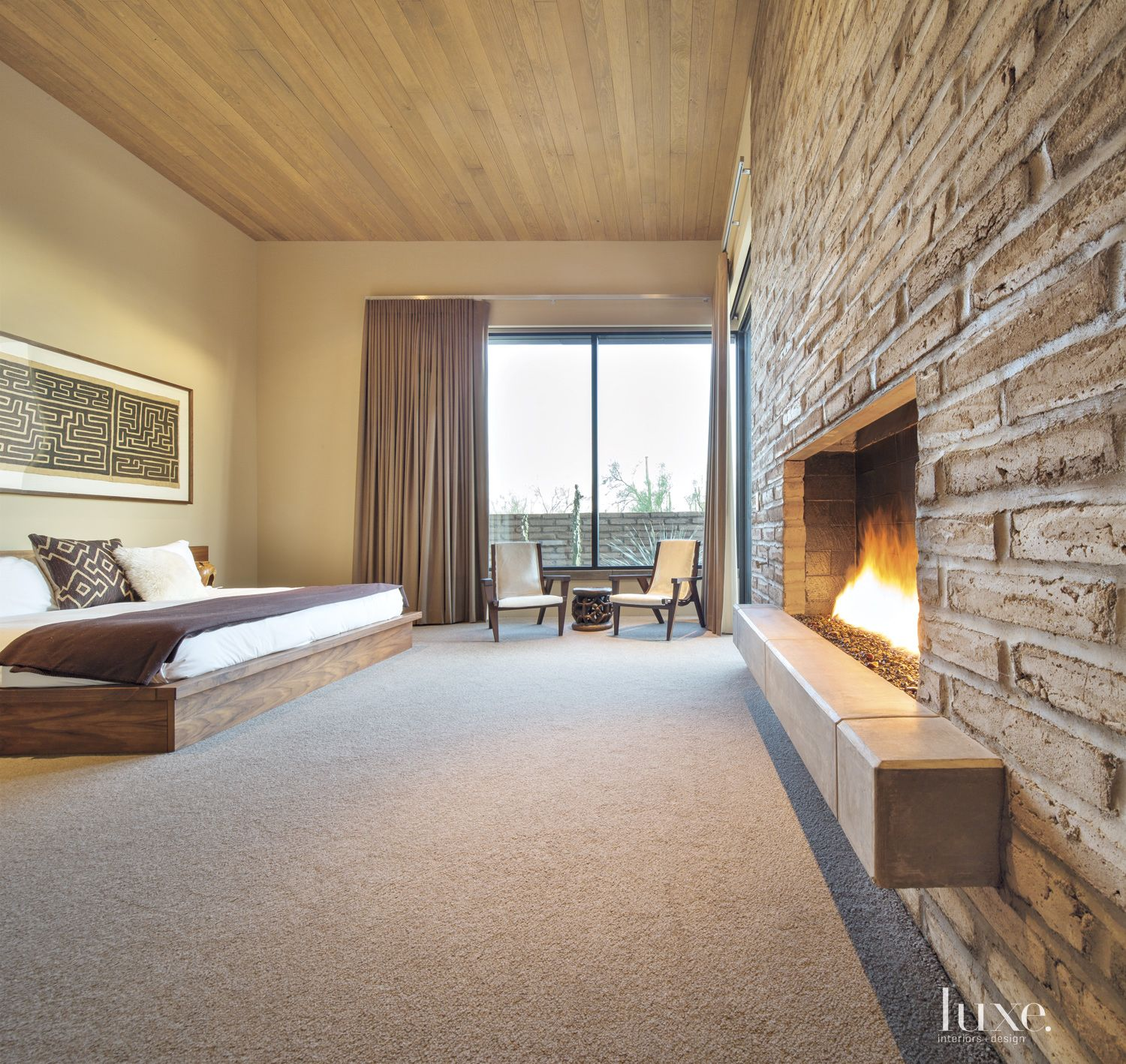 Contemporary Neutral Bedroom with Brick Fireplace