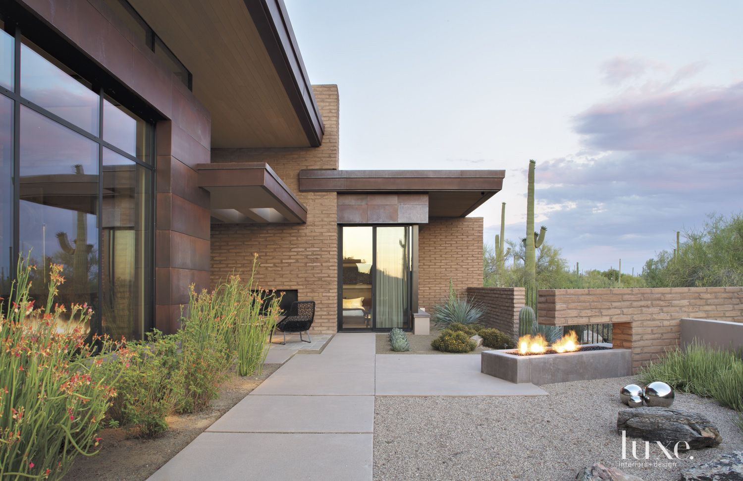 Contemporary Neutral Exterior with Raised Firepit