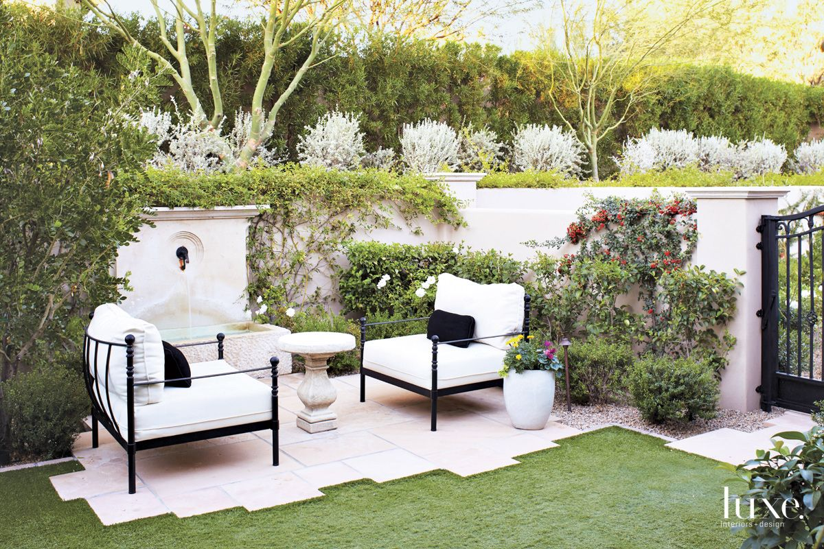 Neutral Mediterranean Outdoor Sitting Area with Limestone Fountain