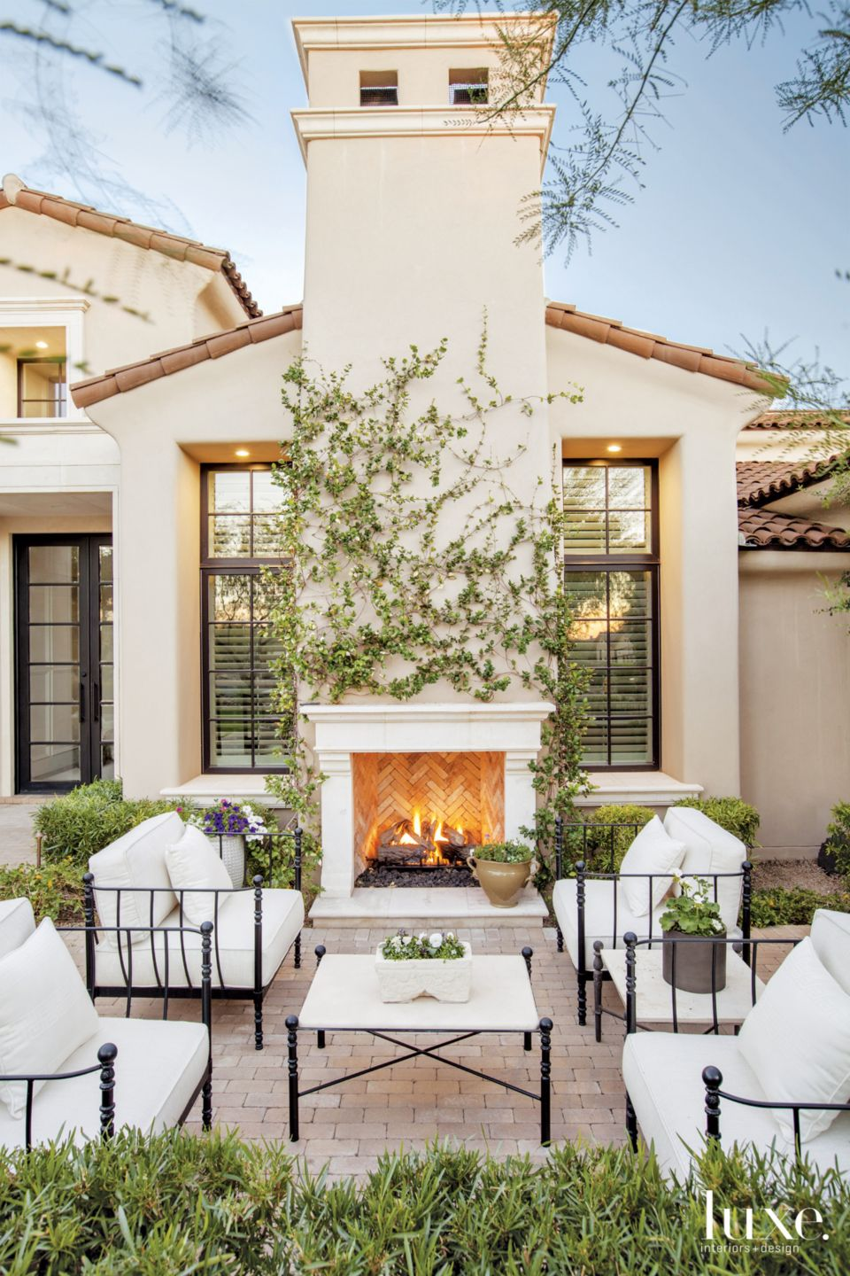 Mediterranean Cream Exterior with Outdoor Seating Area