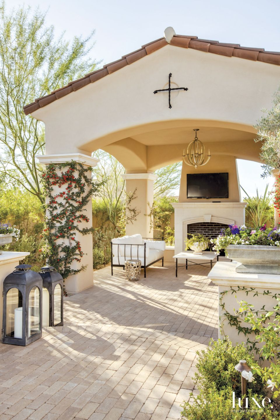 Mediterranean Outdoor Living Room with Limestone Fireplace