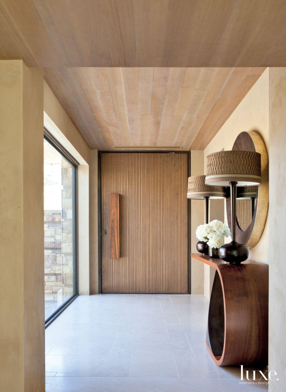 Contemporary Cream Entryway with Bronze Door