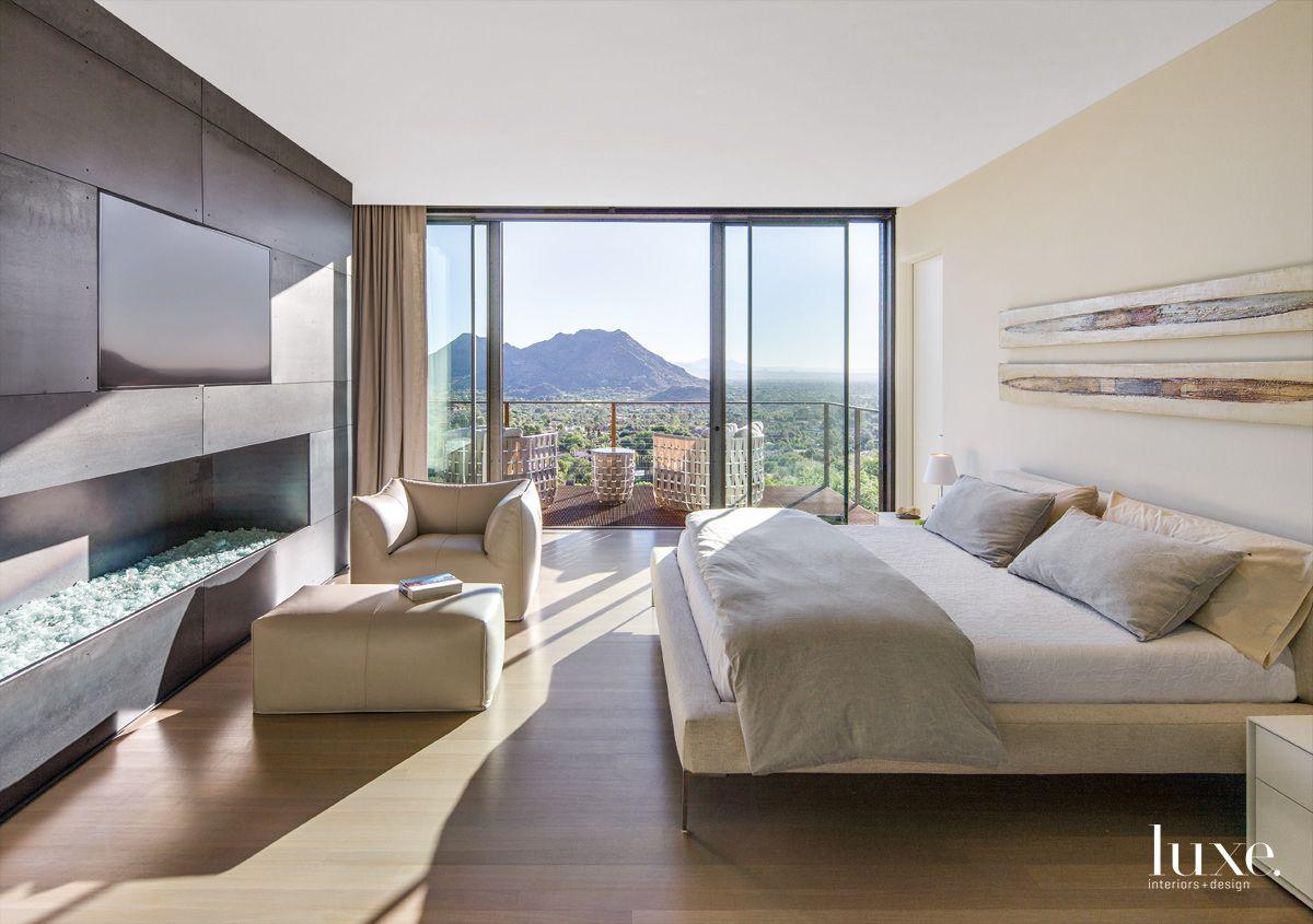 Modern Cream Master Bedroom with Custom Steel Fireplace