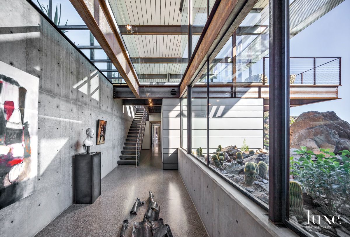 Modern Gray Art Gallery with Floating Glass Bridge Above