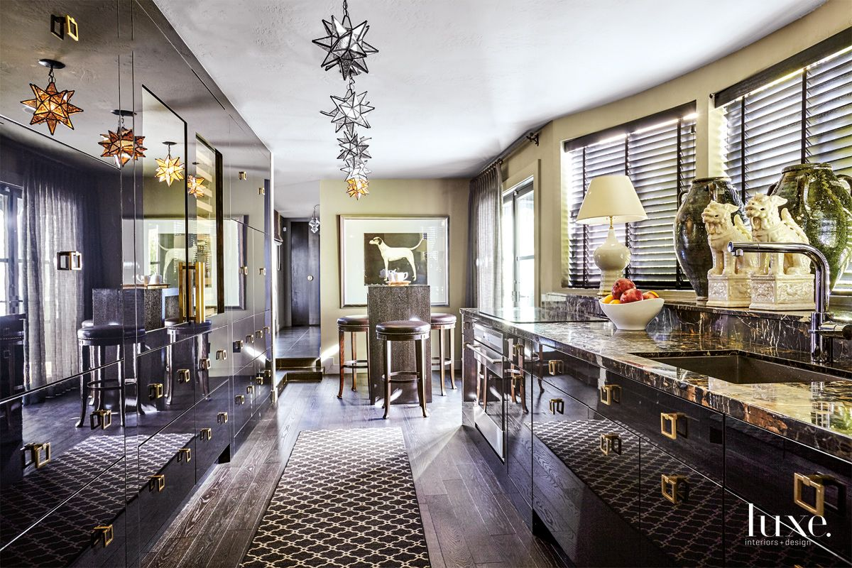 Transitional Cream Kitchen with Black-Lacquer Cabinets