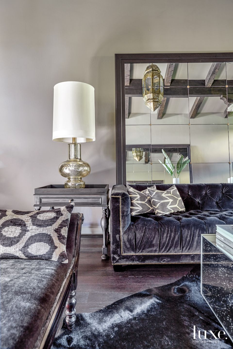 Transitional Cream Living Room with Tufted Black Sofas