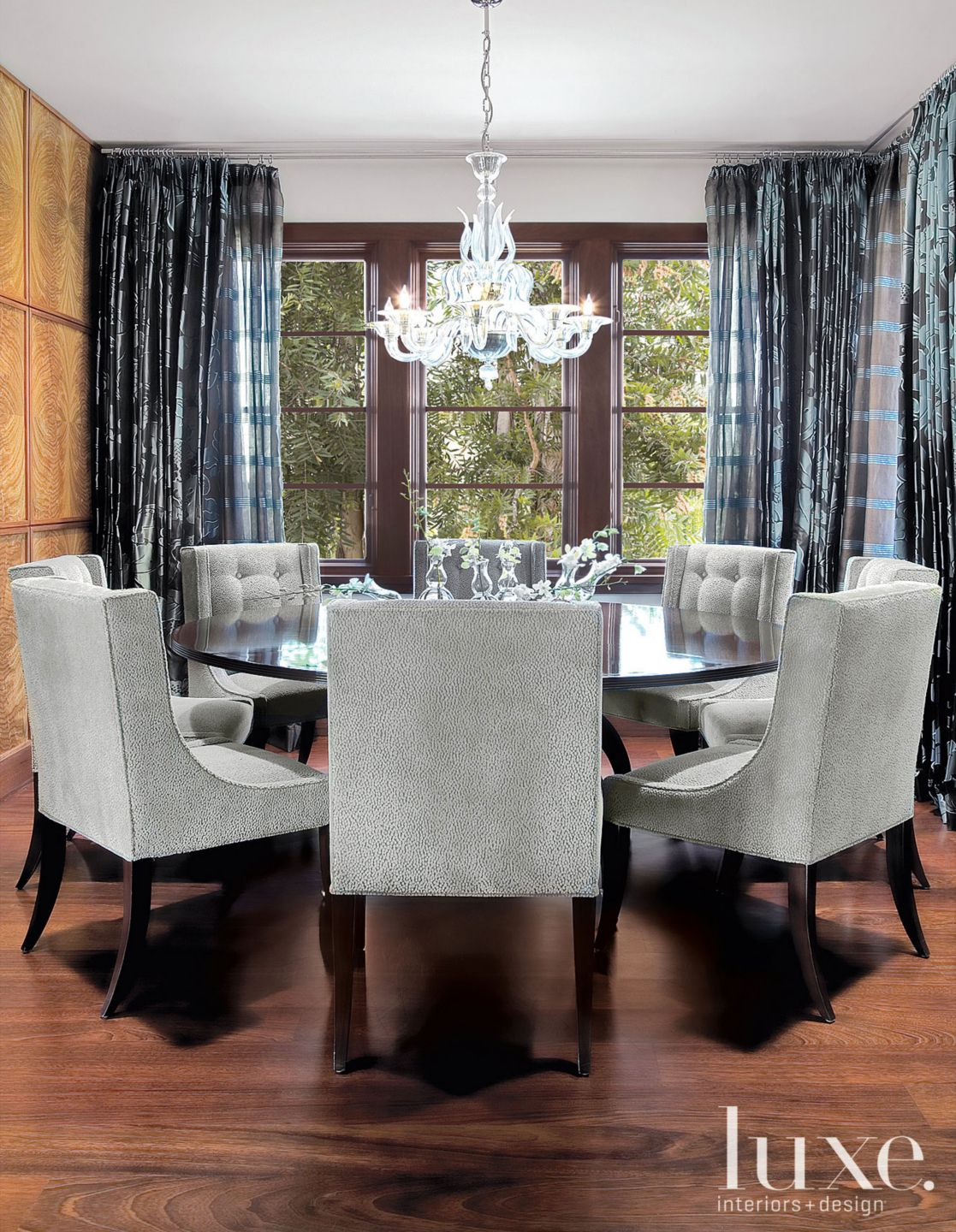 Eclectic Neutral Dining Room with Glass Chandelier