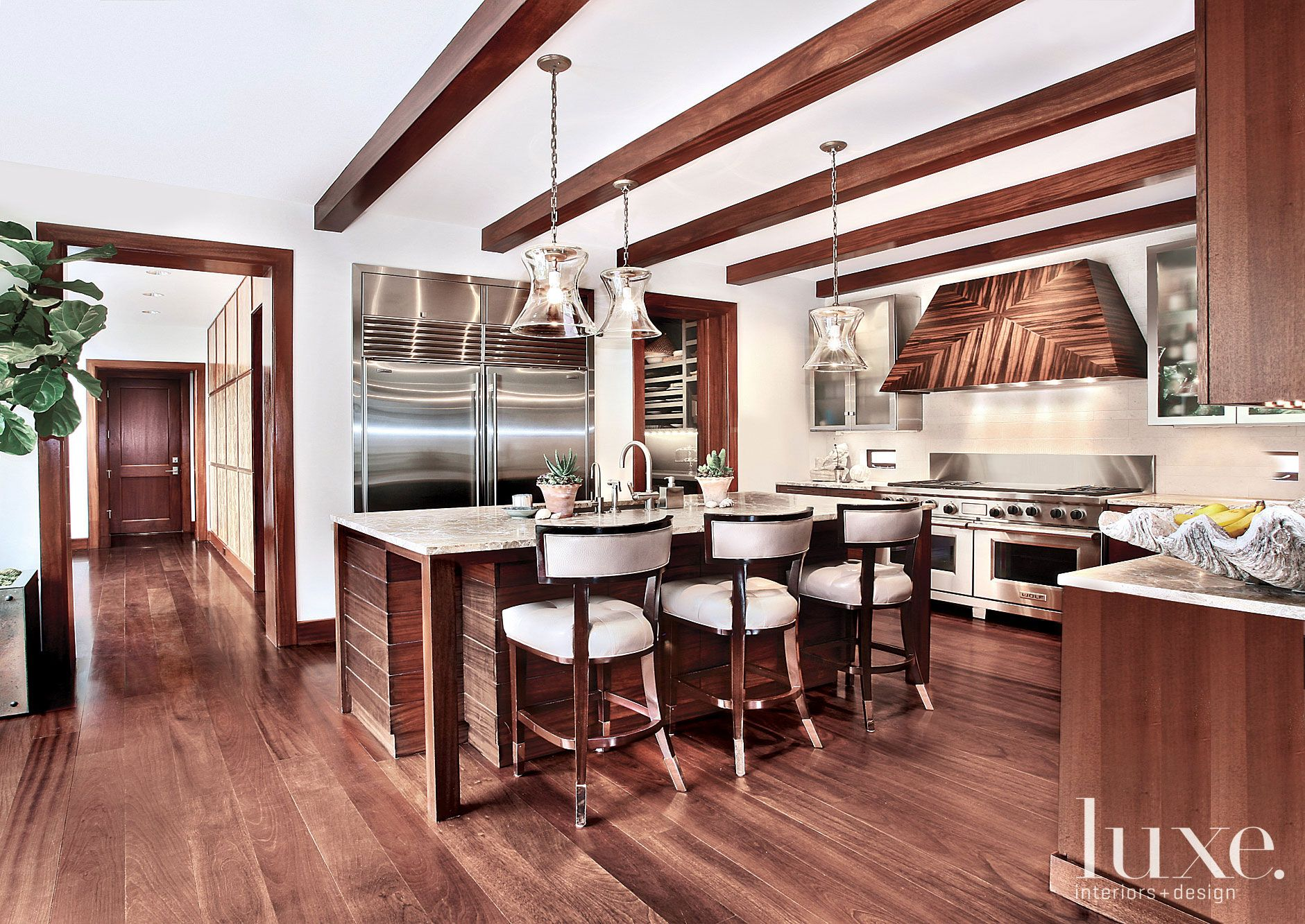 Contemporary White Kitchen with Exposed Wood Beams