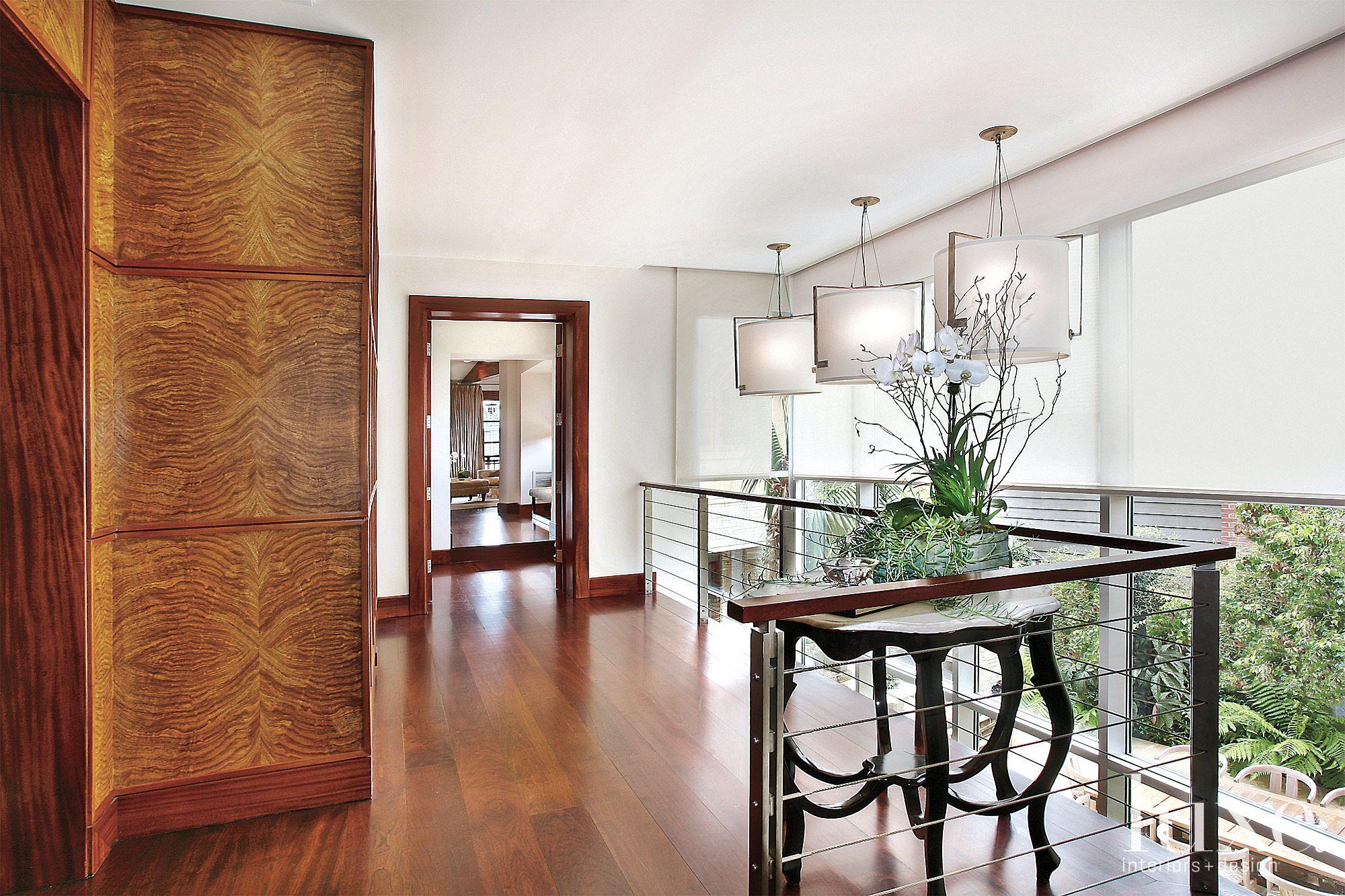 Contemporary White Hallway with Mahogany Paneling