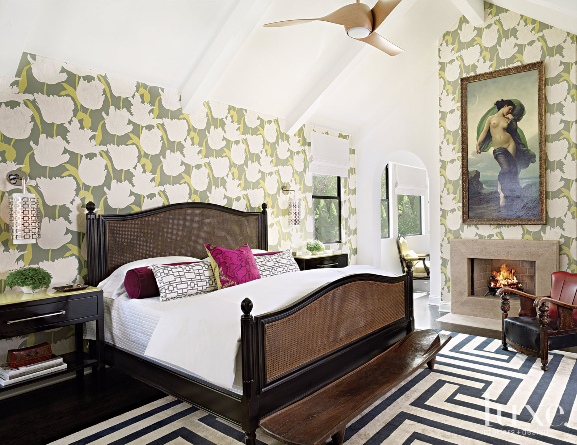 Eclectic White Bedroom with Fireplace