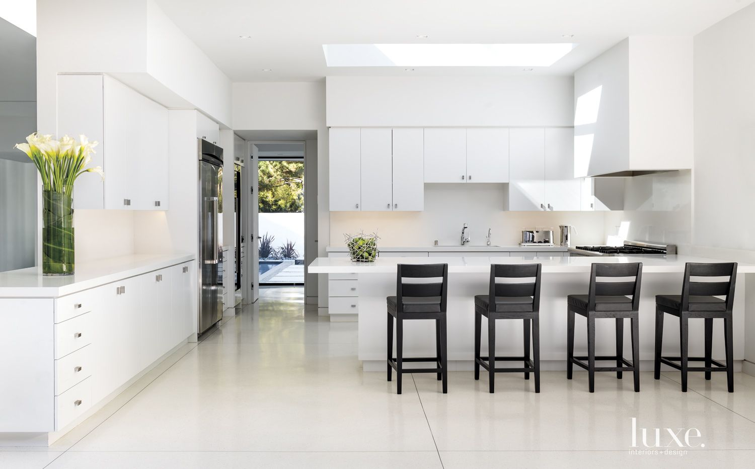 Modern White Kitchen with Lacquered Cabinetry