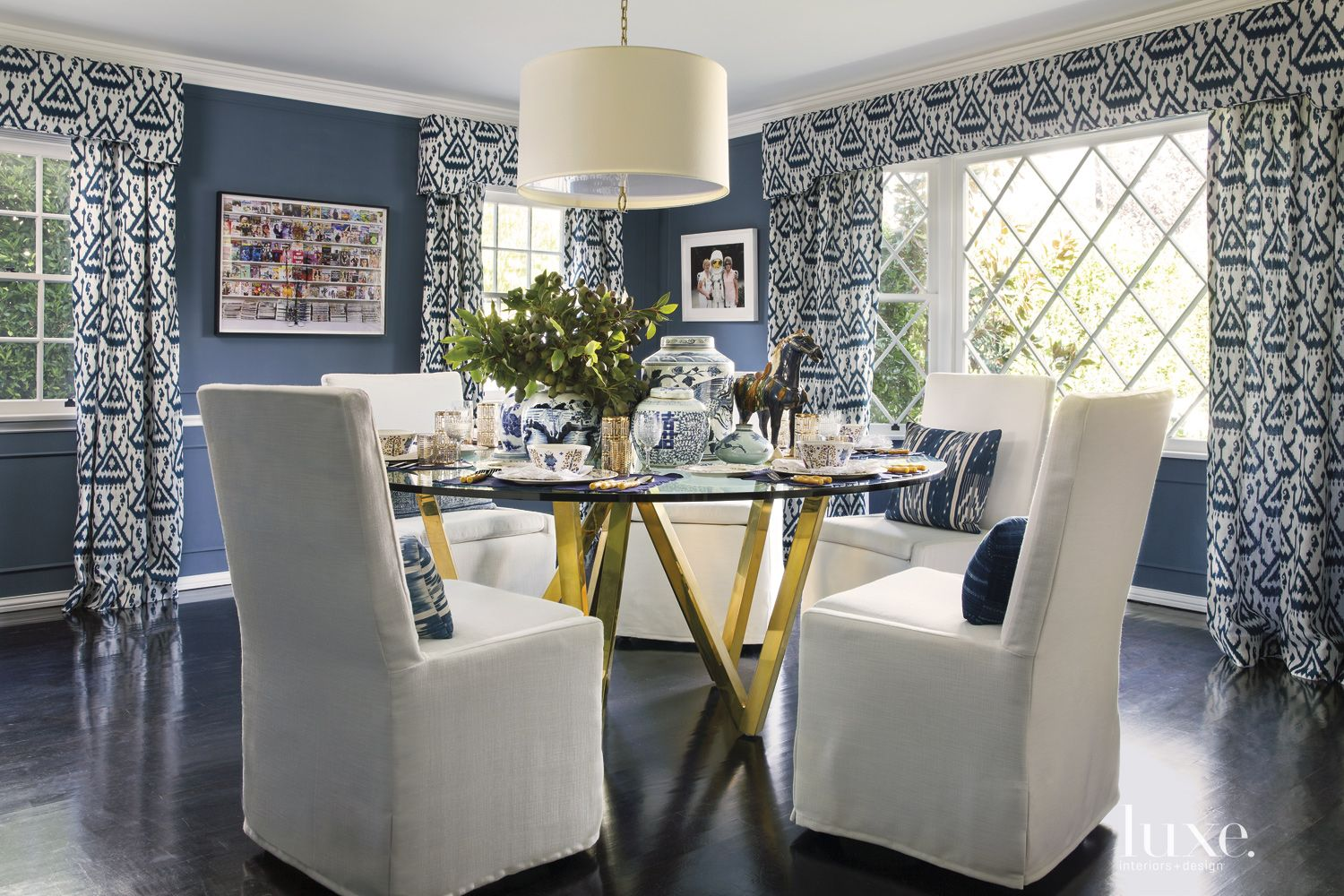 Eclectic Blue Dining Room with Polished-Brass Table