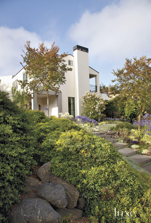 Contemporary White Hillside Exterior Landscape
