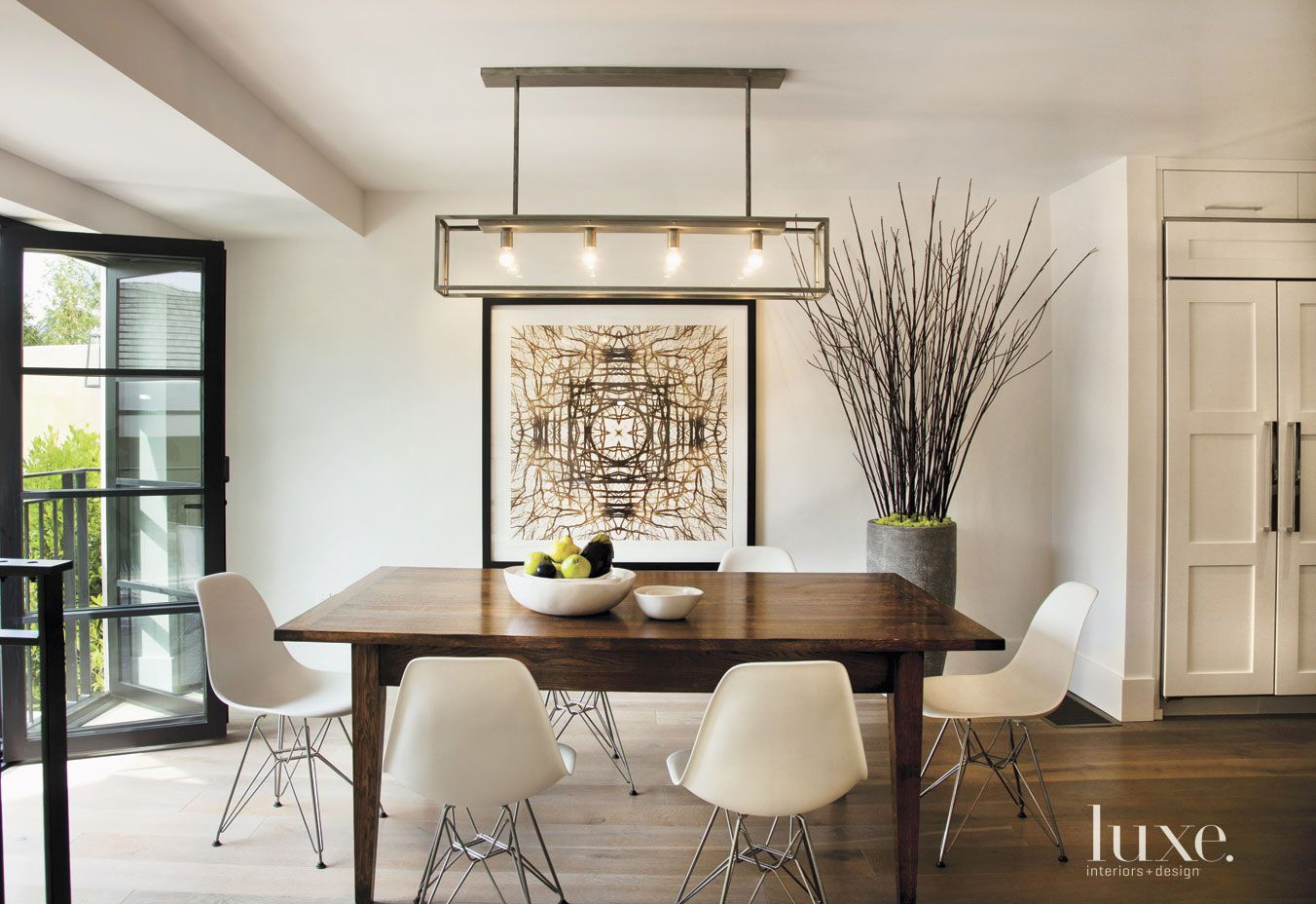 Contemporary White Dining Room with Geometric Pendant