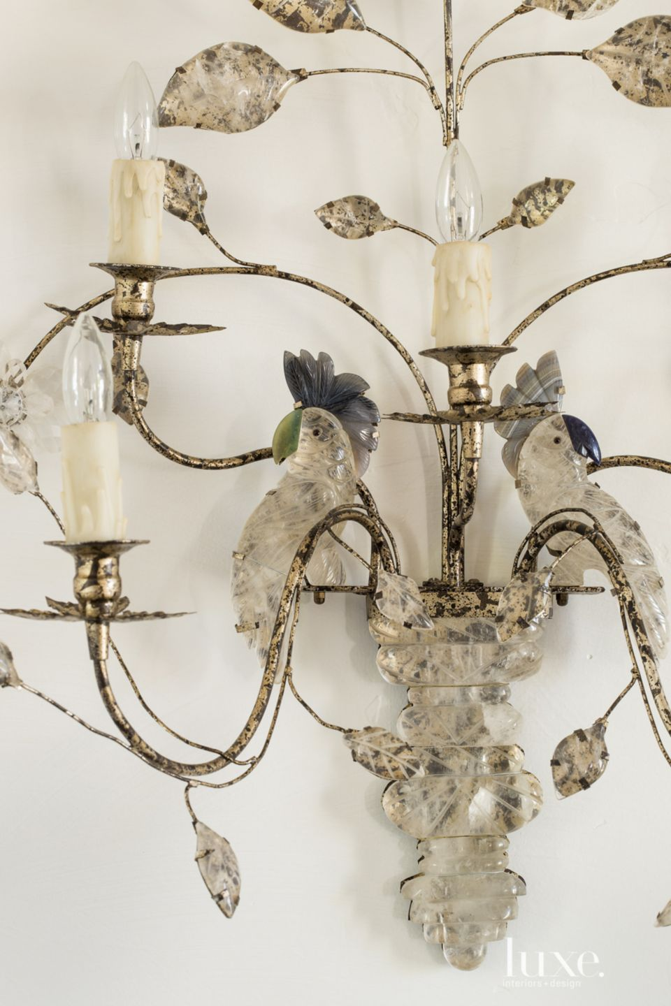 Transitional White Dining Room Detail with Crystal Sconce