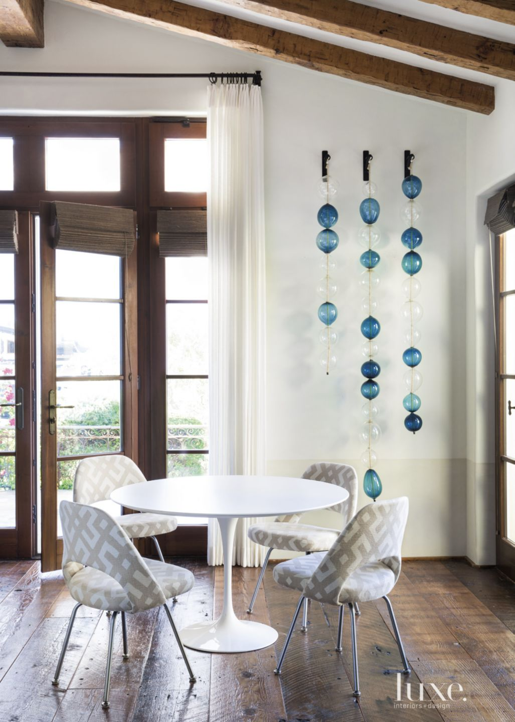 Transitional White Family Room Detail with Saarinen Table