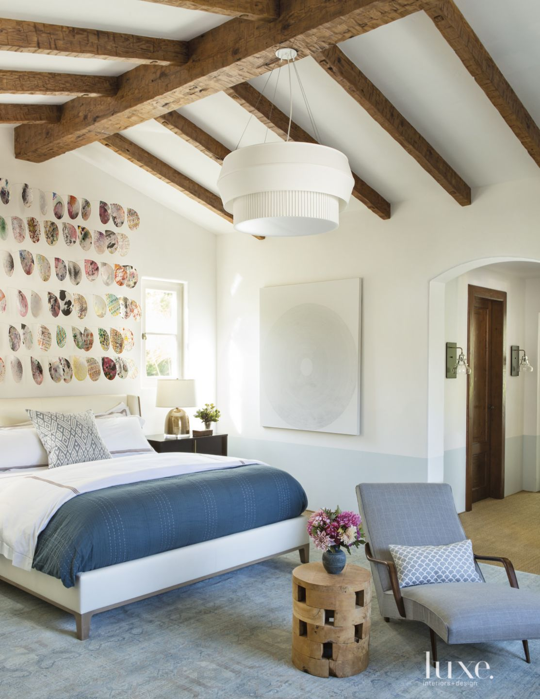 Transitional White Bedroom with Vaulted Ceiling