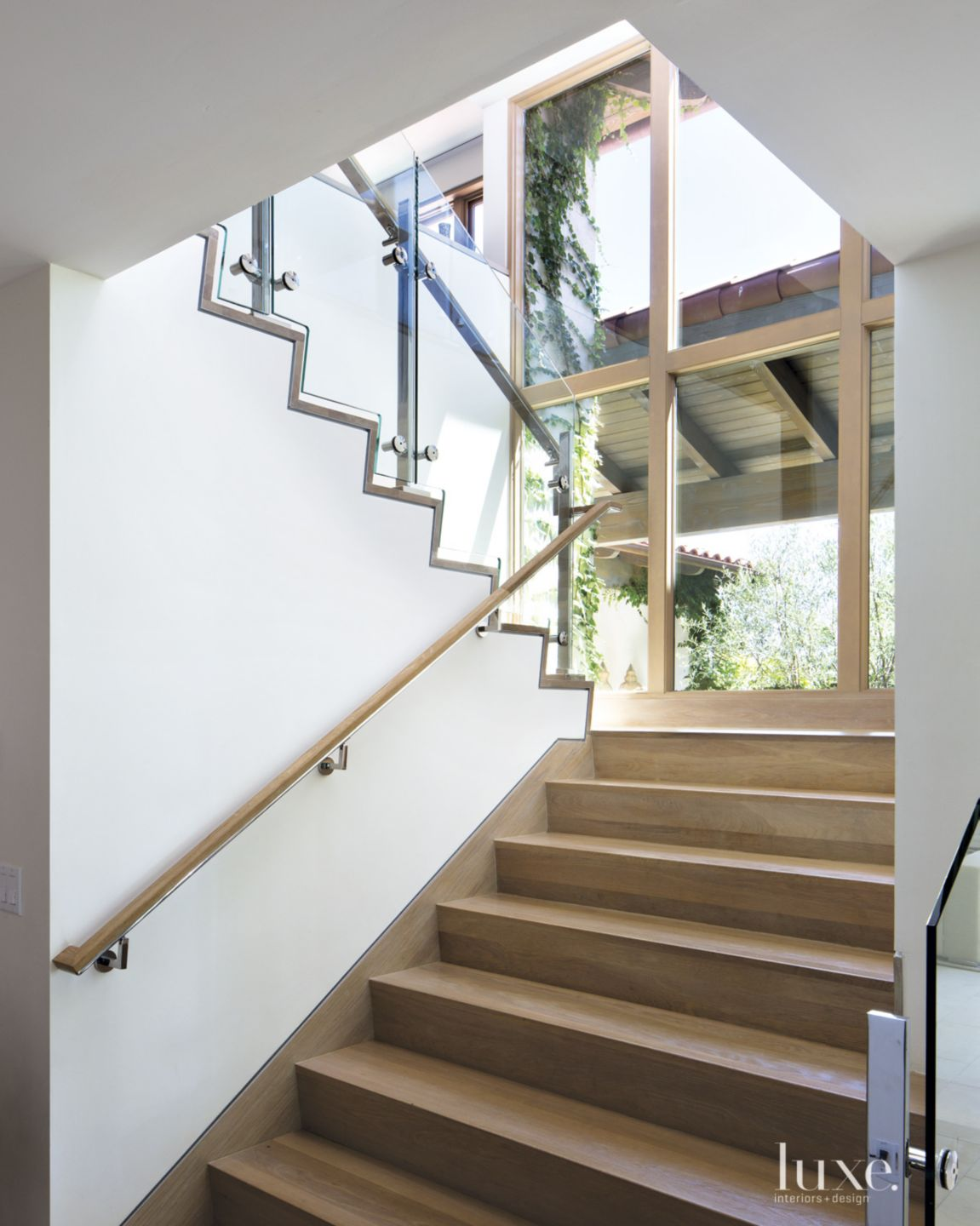 Contemporary White Staircase with Picture Windows