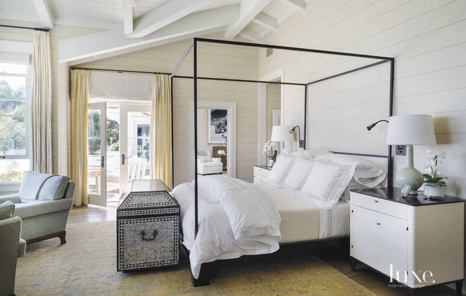 Contemporary White Bedroom with Open-Beam Ceiling