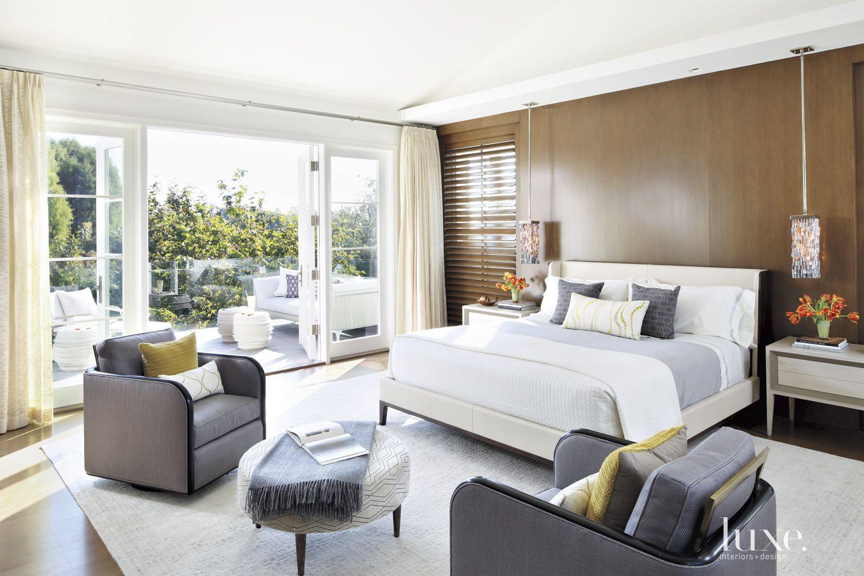 Contemporary Cream Master Bedroom with Porch