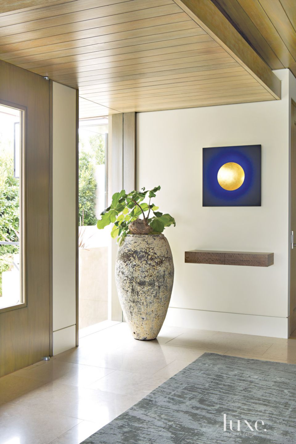 Contemporary Neutral Foyer with Ceramic Vessel