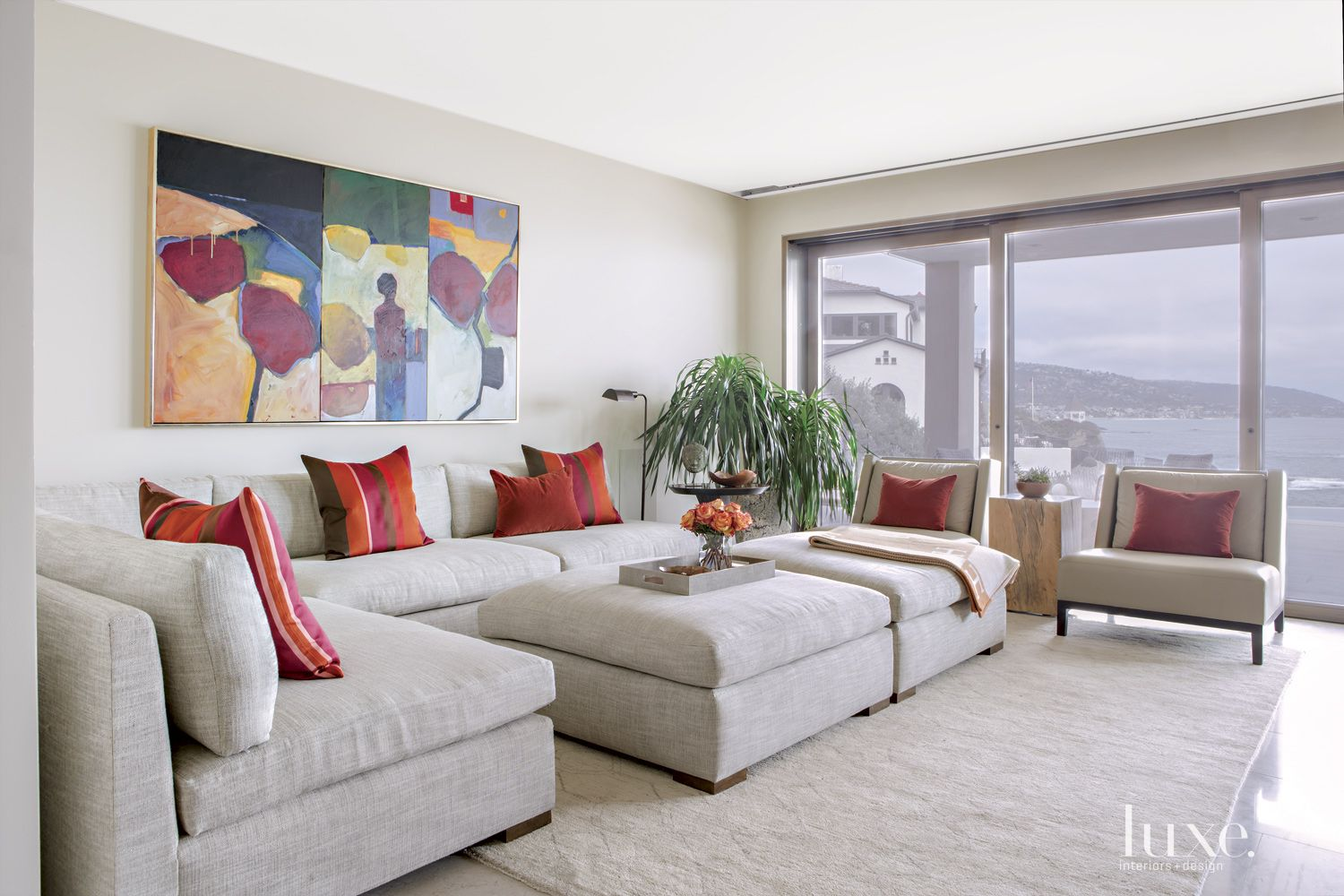 Contemporary Neutral Living Room with Red Accents