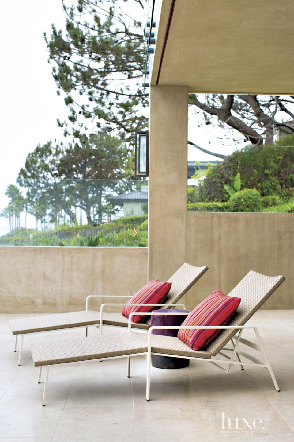 Contemporary Neutral Exterior with Chaise Lounges