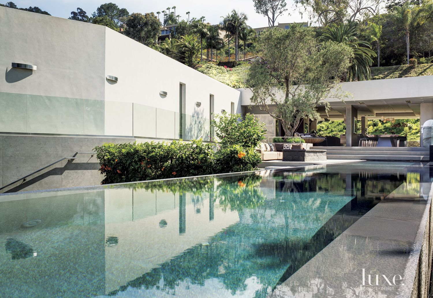 Contemporary Gray Exterior with Vanishing Edge Pool