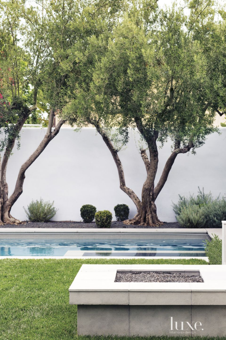 Spanish Colonial Neutral Pool with Sitting Ledge