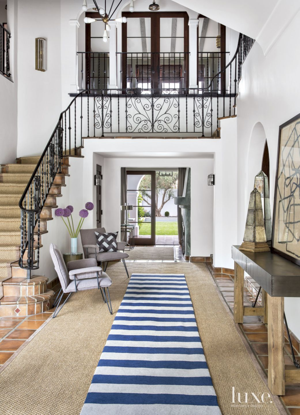 Spanish Colonial Neutral Entry with Purple Chairs